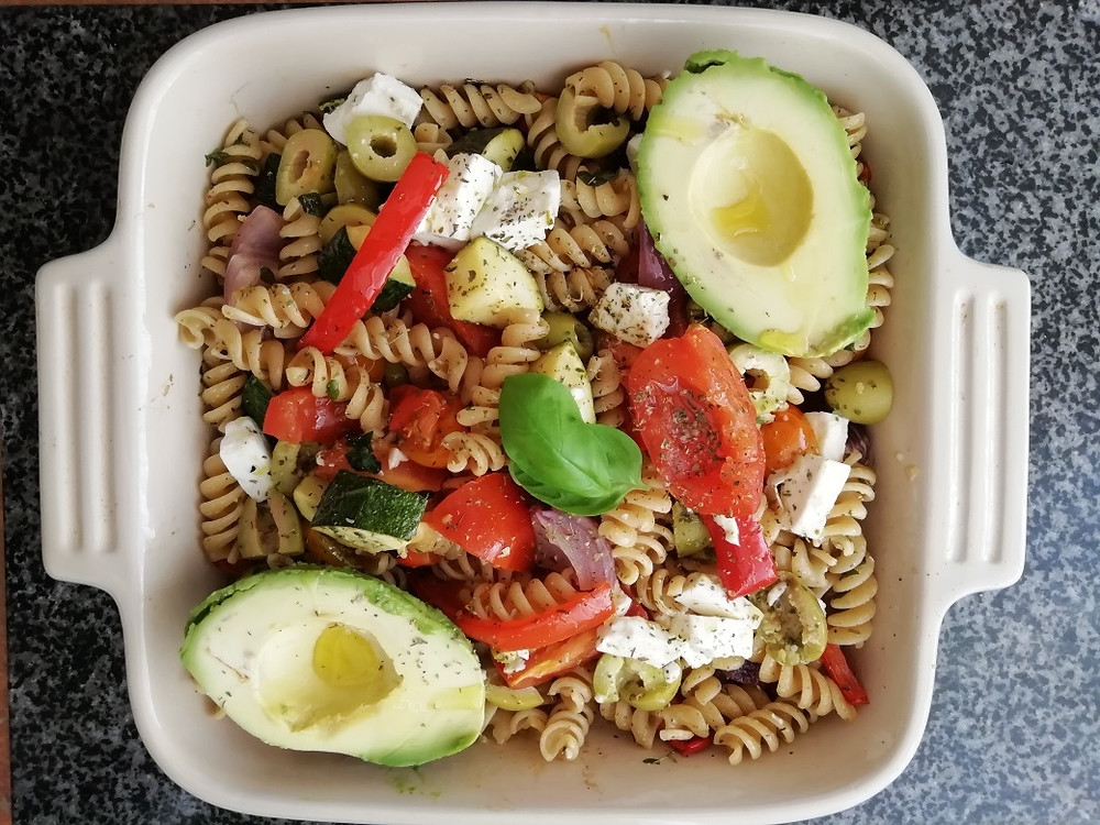 a home made vegetarian past salad which includes fresh vegetables, whole meal pasta and avocado