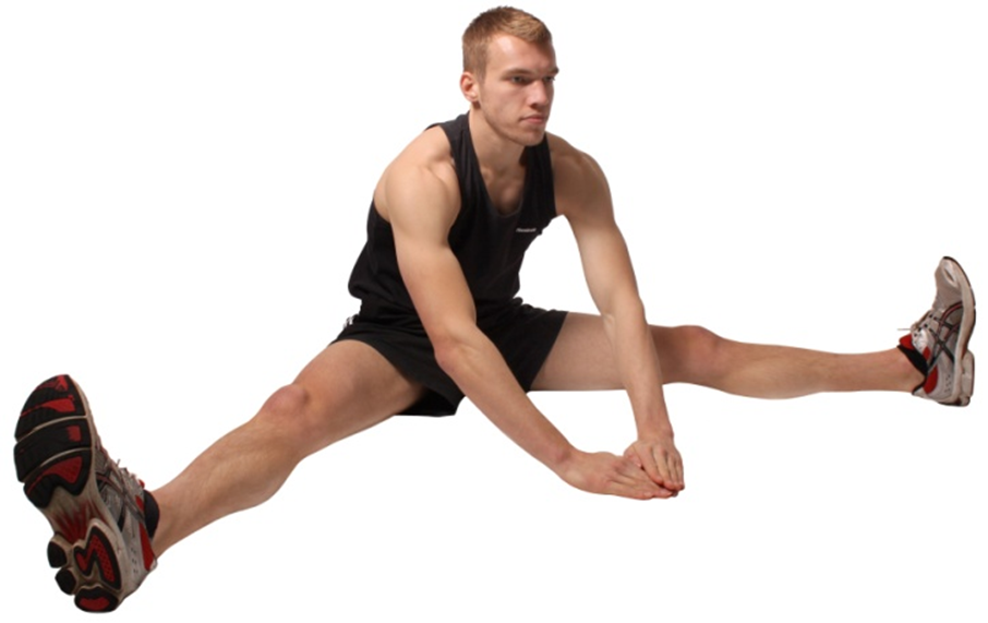 a man performing a flexibility exercise that stretches his abductor and hamstring muscles
