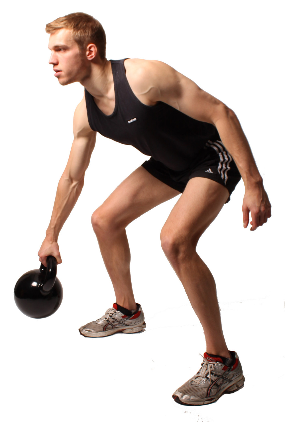 a man performing the kettlebell under the leg pass exercise