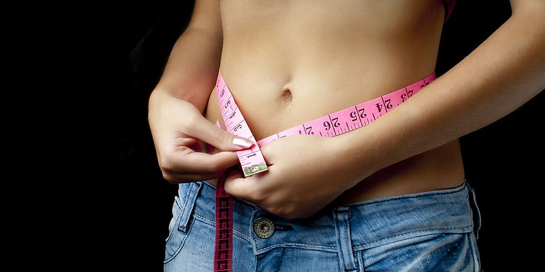 An image of woman with a measuring tape around her waist. This image heads the Hungry4Fitness Weight-Loss Programme.