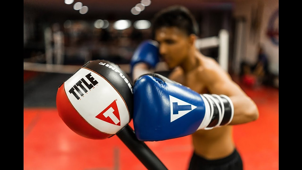 A boxer training on a boxing reflex bag.
