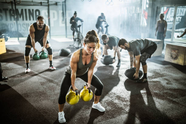 A group of people taking part in a high-intensity circuit workout. This image heads the article that looks at the 5 advantages of circuit training.