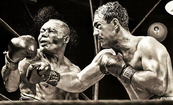 rocky Marciano delivering a crushing right hand to joe walcott