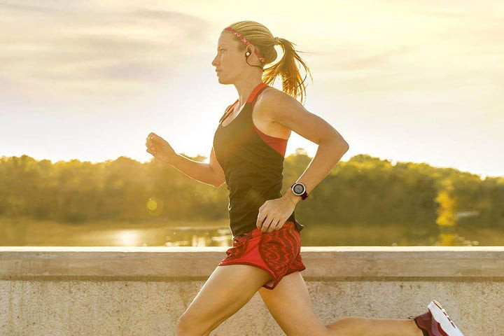 a woman running with a pedometer on her wrist