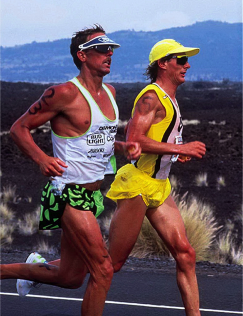 two men running side by side competing in the Hawaiian Iornman
