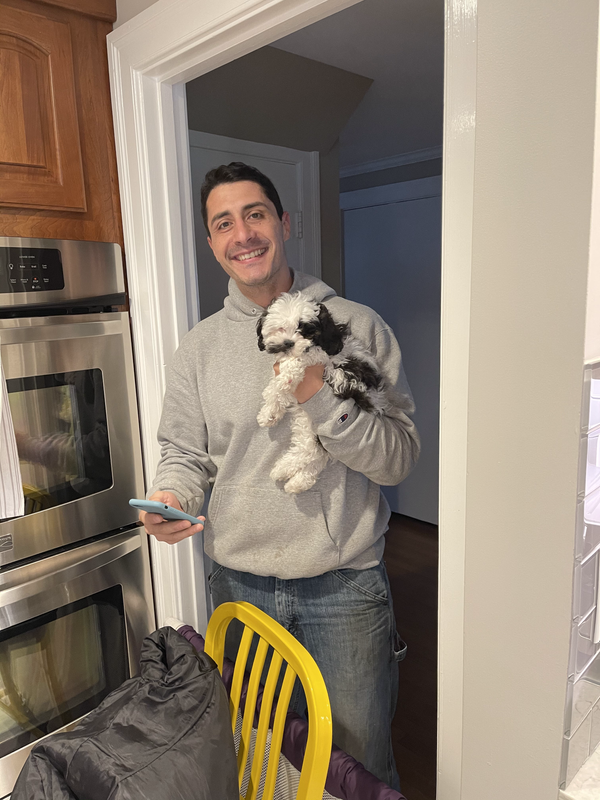 Roy meeting a client's new puppy.