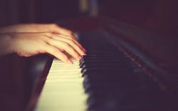 Hands Of Woman Pianist On Piano Keyboard.jpg