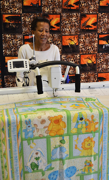 Dudu working on a long arm quilting mach