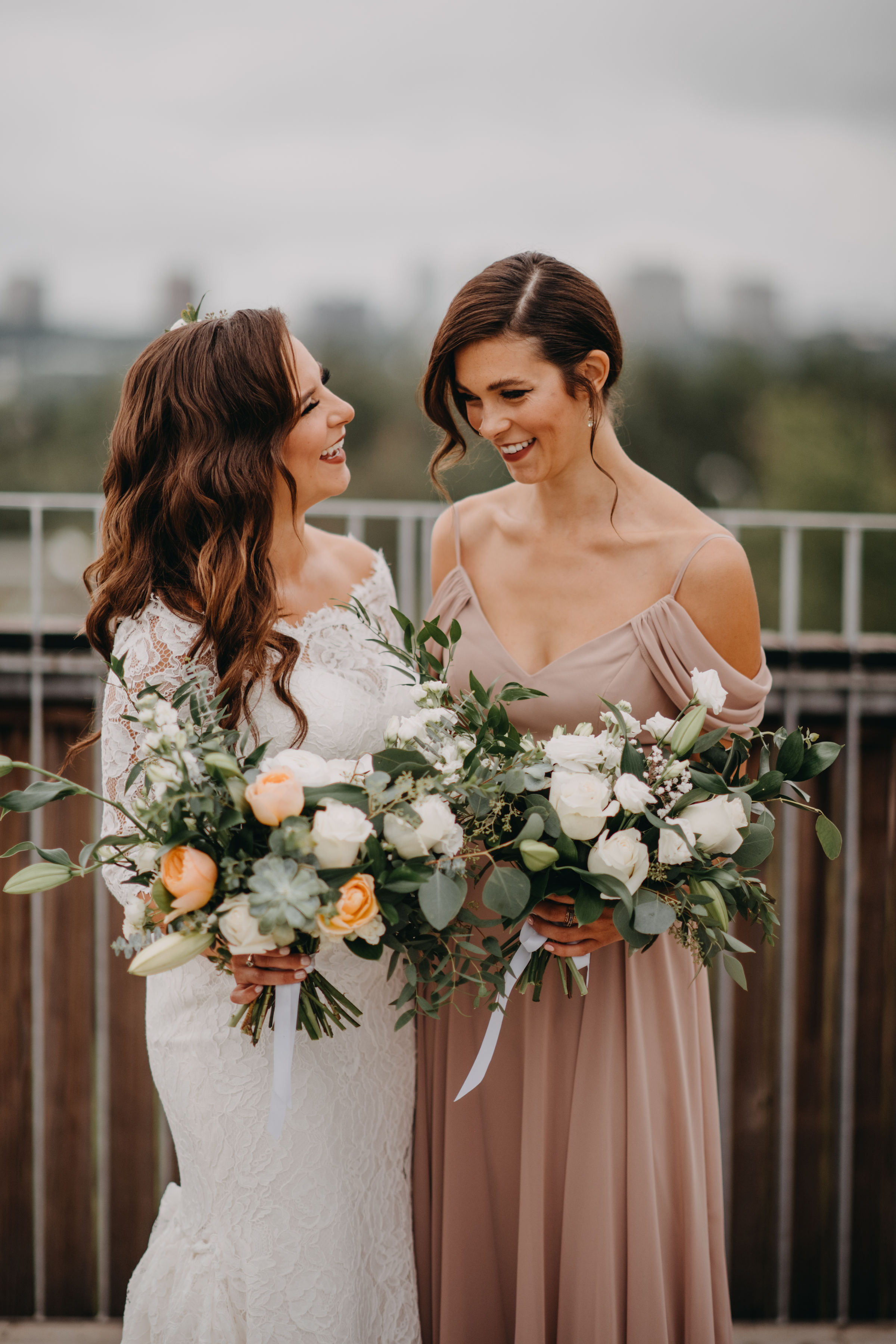 sisters smiling with bouquets