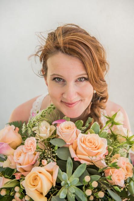 bride smiling in  bouquet.jpg