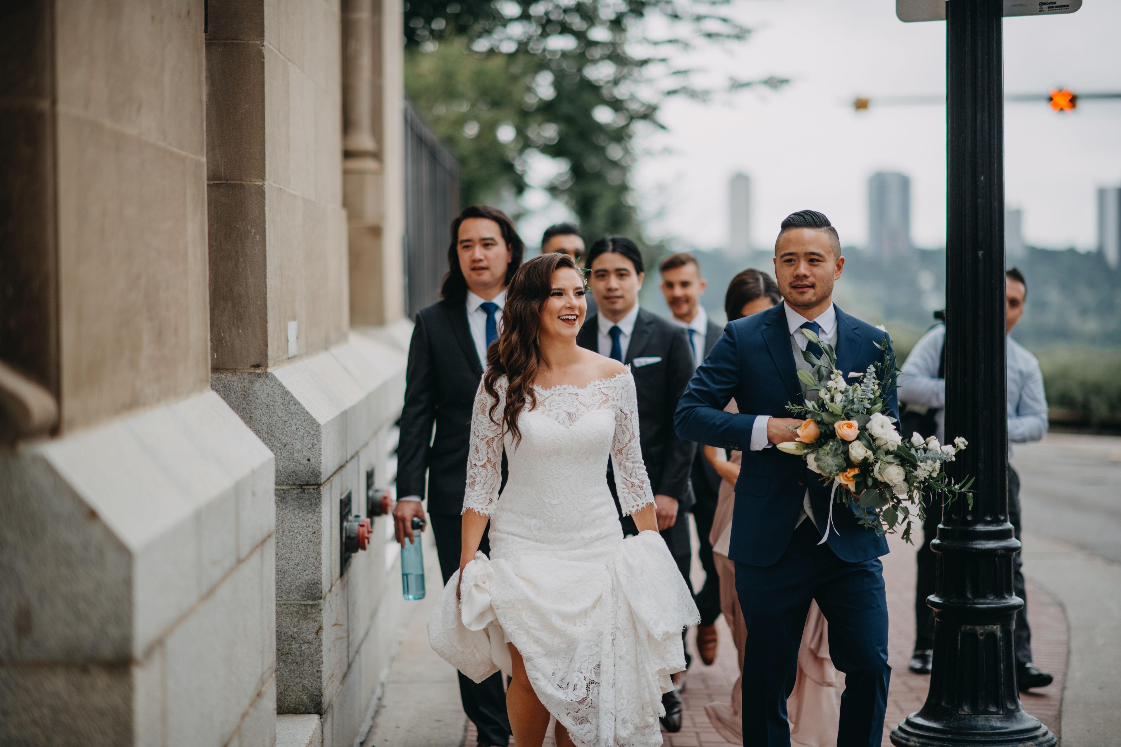 groom carrying bouquet