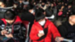 passengers-wearing-masks-are-seen-at-the