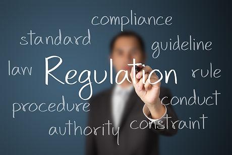 business man writing regulation concept.
