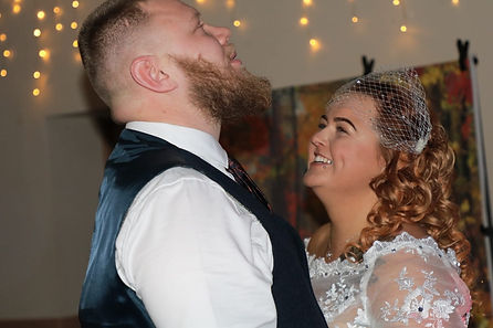 Bride and groom laughing together during their wedding ceremony