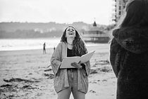 Sian laughing during a ceremony on Swansea Bay