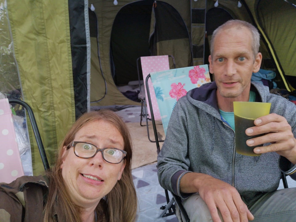 Two of Sian's friends, Rachel and Mike, having a drink and enjoying camping in a friend's field.
