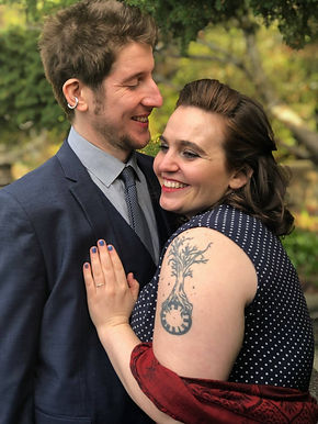 Bride and groon holding eachother smiling happliy after their humanist ceremony