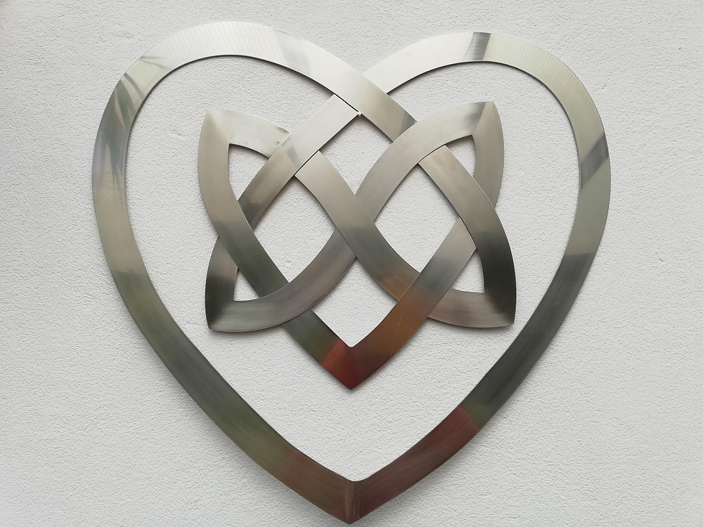 A photograph of a beautiful stainless steel celtic knot that Sian's dad made for her as a logo for her wedding business.