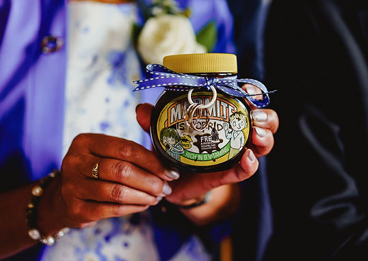 A Marmite jar with two wedding rings tied to it held my the mother of the groom