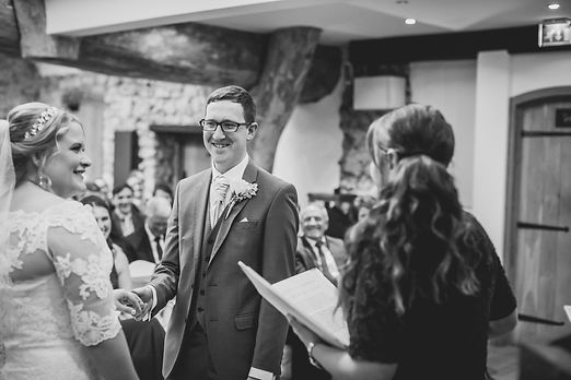 Sian Jackson celebrant marrying a smiling, happy couple on a winter's day in the Oxwich Bay hotel