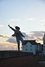 Sian the celebrant balancing on a wall at Swansea Bay