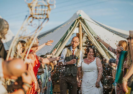 Confetti being showered over a happy couple outside the marquee at the Ceridwen Centre