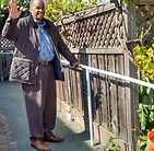 A man uses a guide rail to get around his home