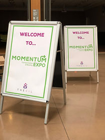 "Two signs read ""Welcome to Momentum Expo"""