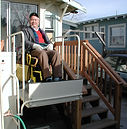 A man uses a new lift at his home