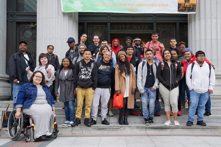 A group photo of students at City Hall