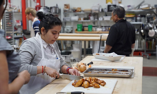 A photo of a girl working in a professional kitchen
