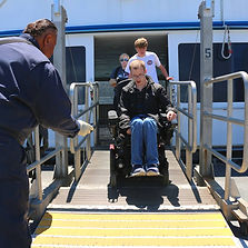 A man in a wheelchair on a ferry