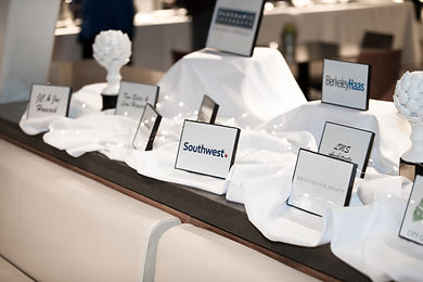 Photo of signs on table displaying sponsors, including Southwest Airlines