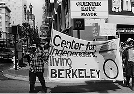 "CIL staffers carry banner reading ""Center for Indpendent Living Berkeley"""