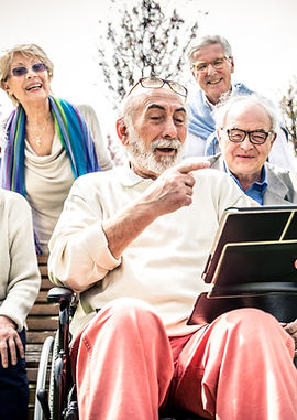 Group of senior people reading a tablet device