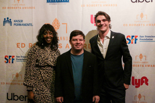 Ed Roberts Award winners Stephanie Thomas, Zack Gottsagen, and RJ Mitte.   Backdrop by Katebackdrop.