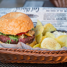 Burger and chips in basket.