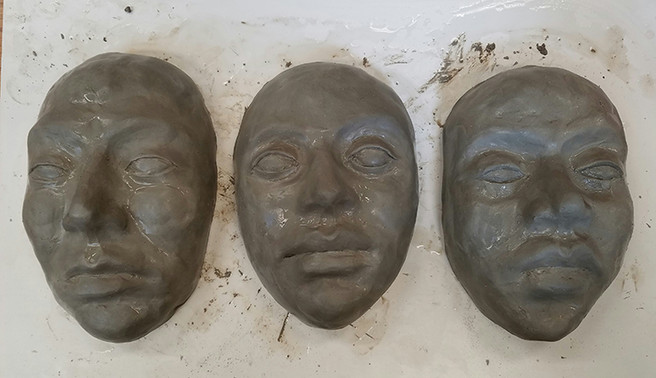Work in Progress - sculpted clay faces prior to plaster mold making