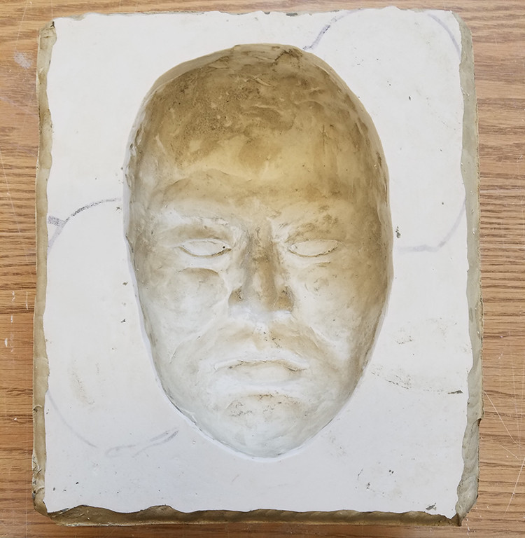 Work in Progress - one of seven plaster molds made from sculpted faces