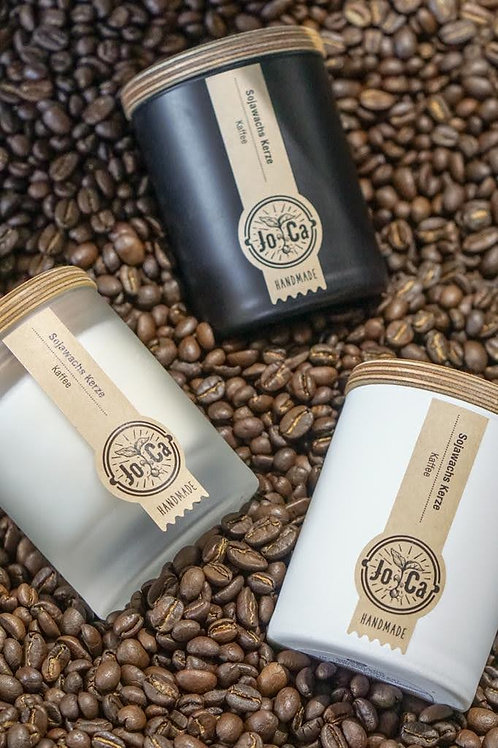 Coffee candles in a bed of coffee beans