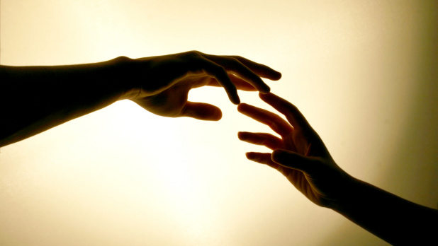 two-hands-touching-620x348