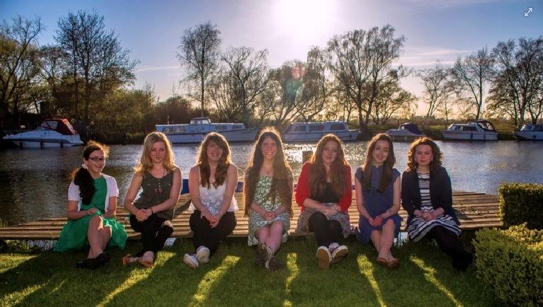 Members of Auriga Capella sitting in the sun.