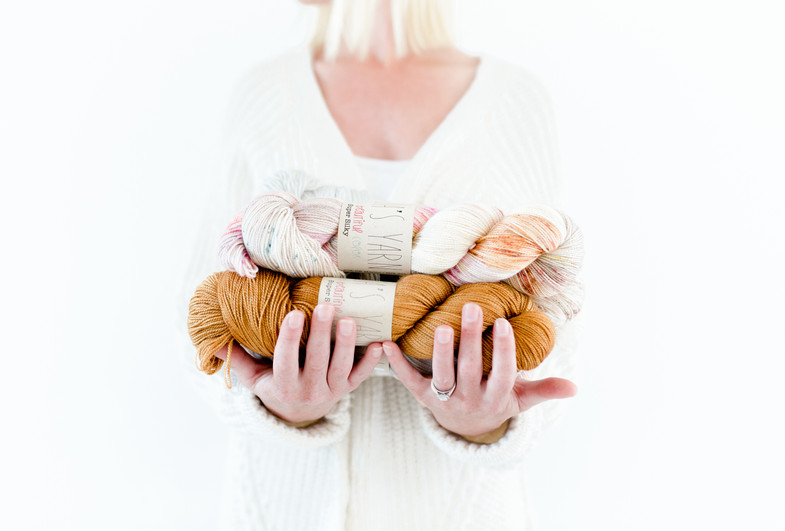 person holding yarn wool lifestyle product shoot