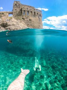 C reaching for N underwater.jpg
