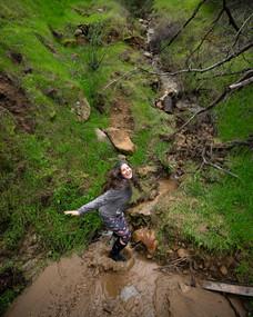 C jumping in rain creek amirs.jpg