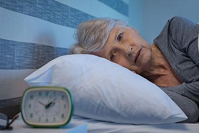 older-woman-staring-at-alarm-clock-night