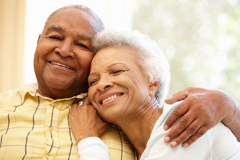 Happer older couple hugging