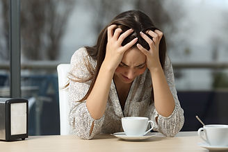 Sad and depressed woman alone in a lonel