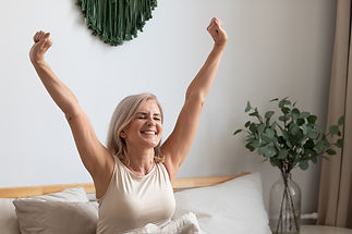 older-woman-waking-up-excited-stretching