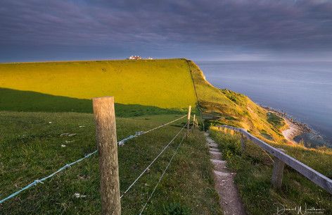 Shadows and light play on St Aldhelms Head in Dorset_